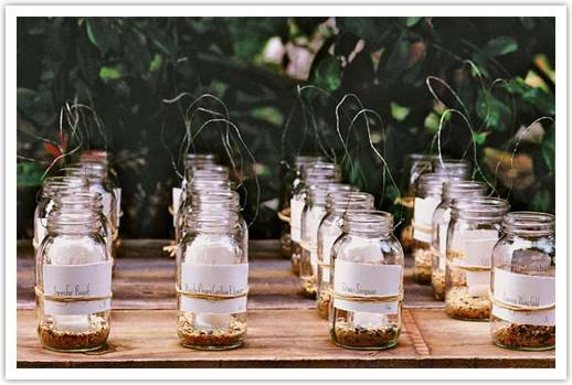 eco chic affair antique glass jars gertrube mabel photography Fun Escort Card Ideas