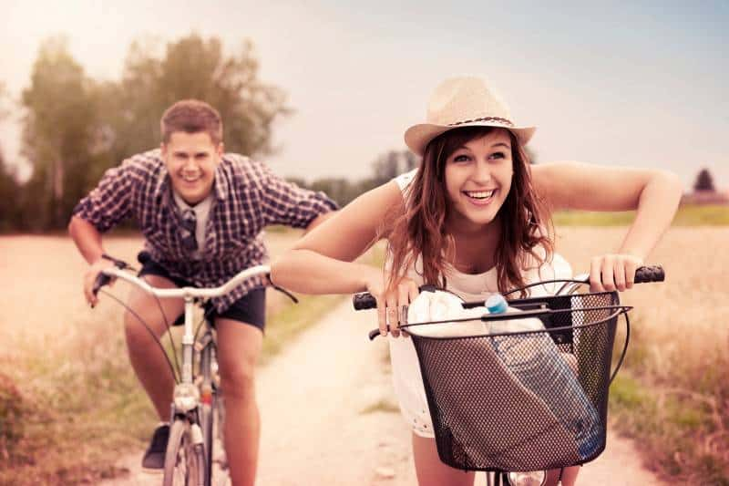 couple riding bicycles 22 Benefits of Being Married: Laughs for a Soon to Be Bride