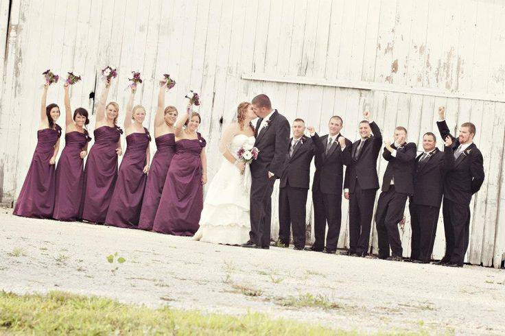 Bride and Groom Kissing and Bridal Party