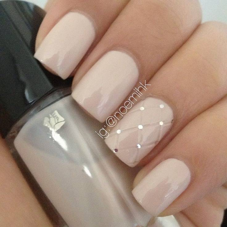 Nude, quilted manicure with rhinestones