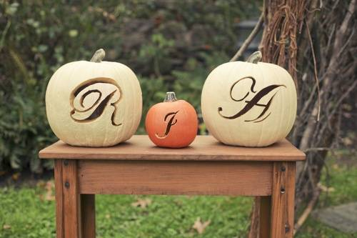 Initials Carved into Pumpkins