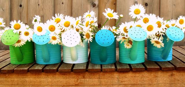 flowers in watering cans Brilliant Garden Wedding Theme Ideas for Every Bride