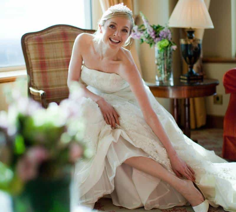Presidential Suite bride laughing June Wedding Facts and Statistics