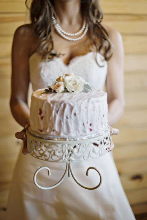 Bride holding real satellite cake by Andie Freeman Photography