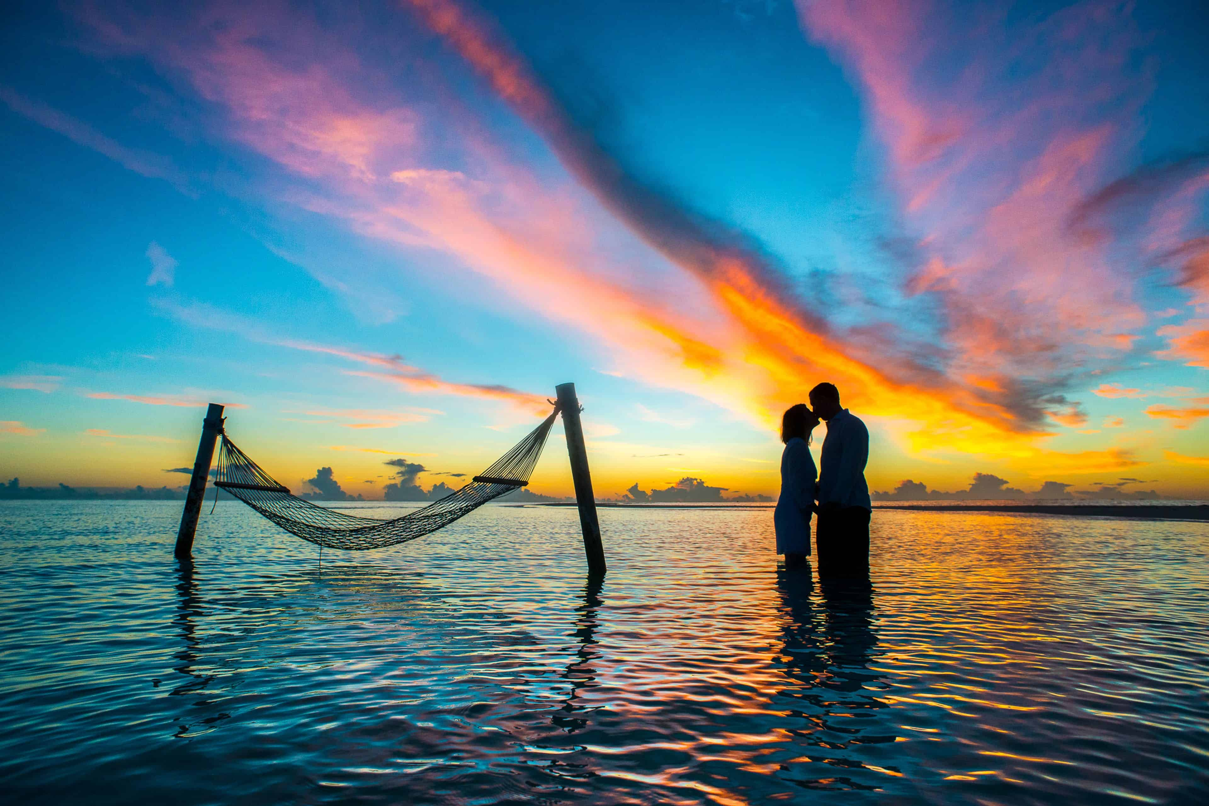 Silhouette Photo Couple Kissing Each Other during Sunset