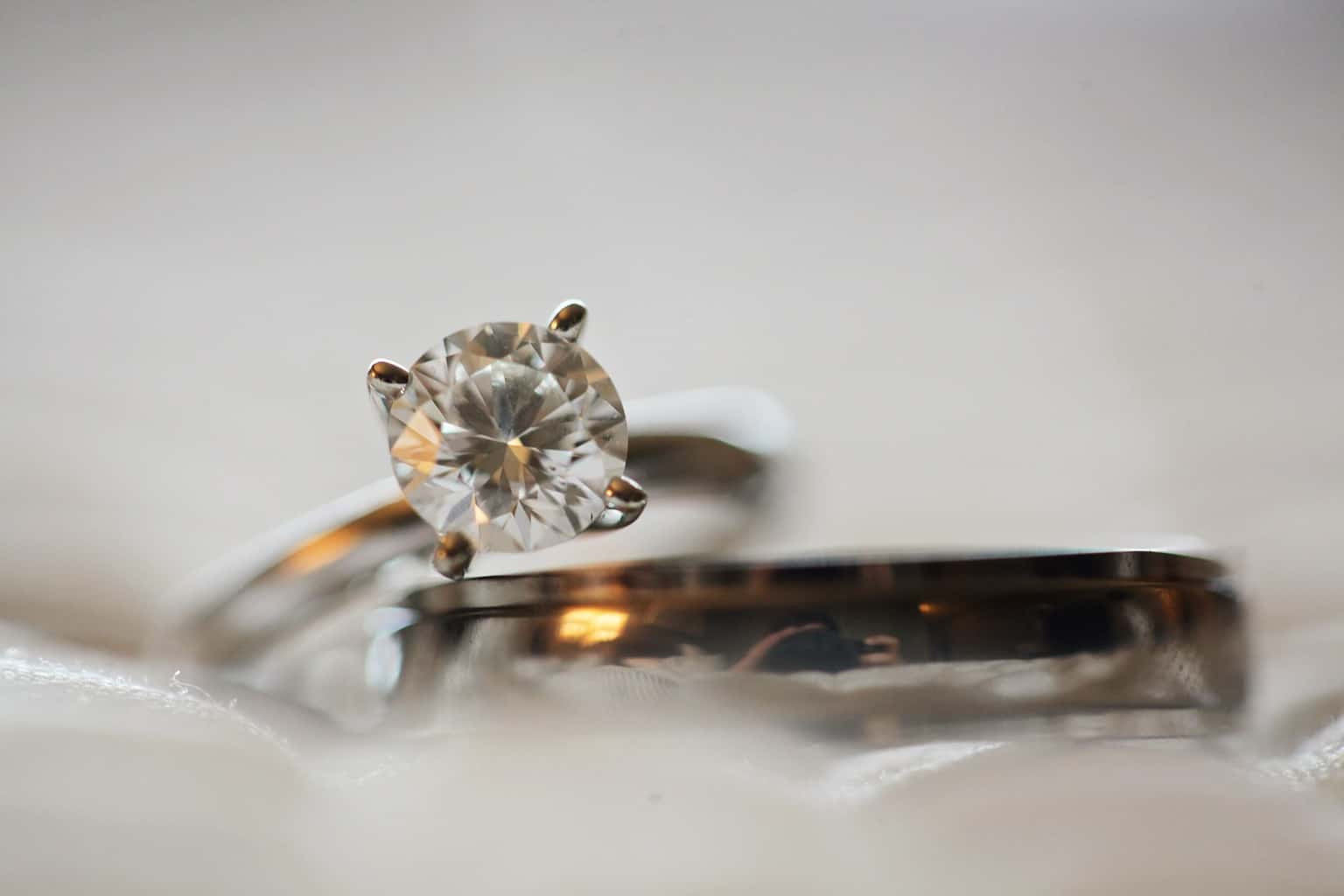 Close Up Photo of Diamond Stud Silver-colored Eternity Ring