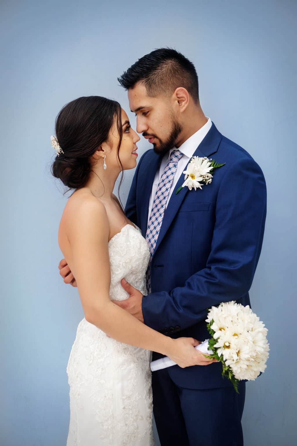 Bride And Groom Standing Next To Each Other