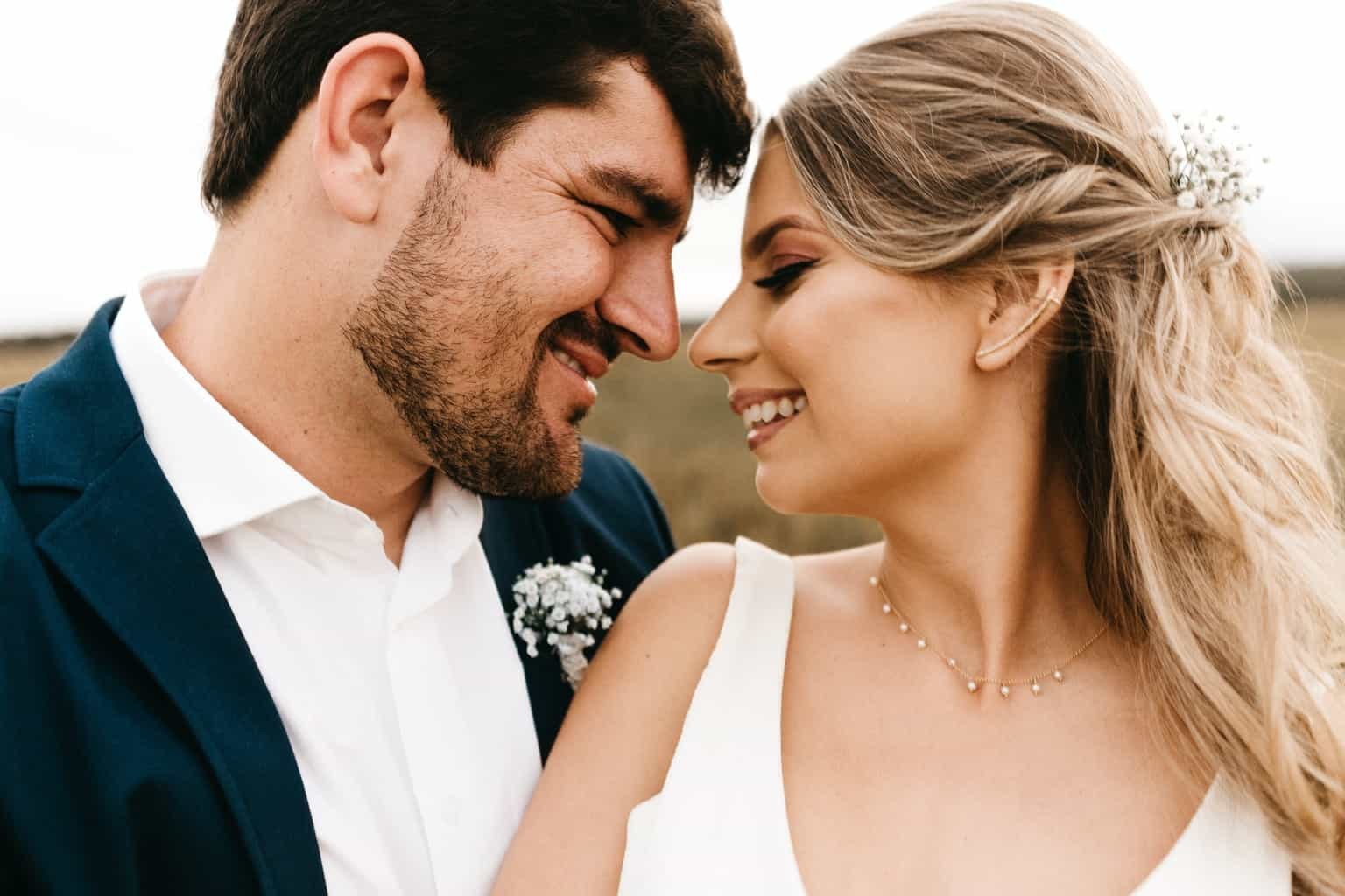 Man and Woman Facing Each Other While Smiling during Day